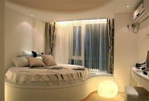 圆形床卧室效果图装修有哪